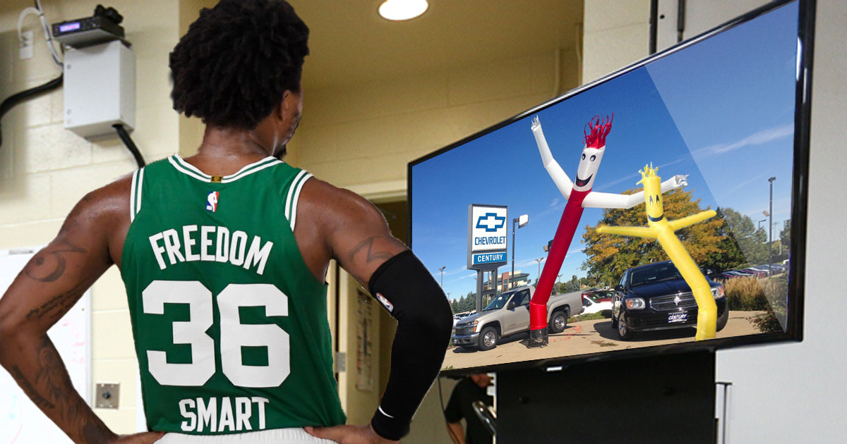 A determined Marcus Smart studies film of wavy arm inflatable guys before big game